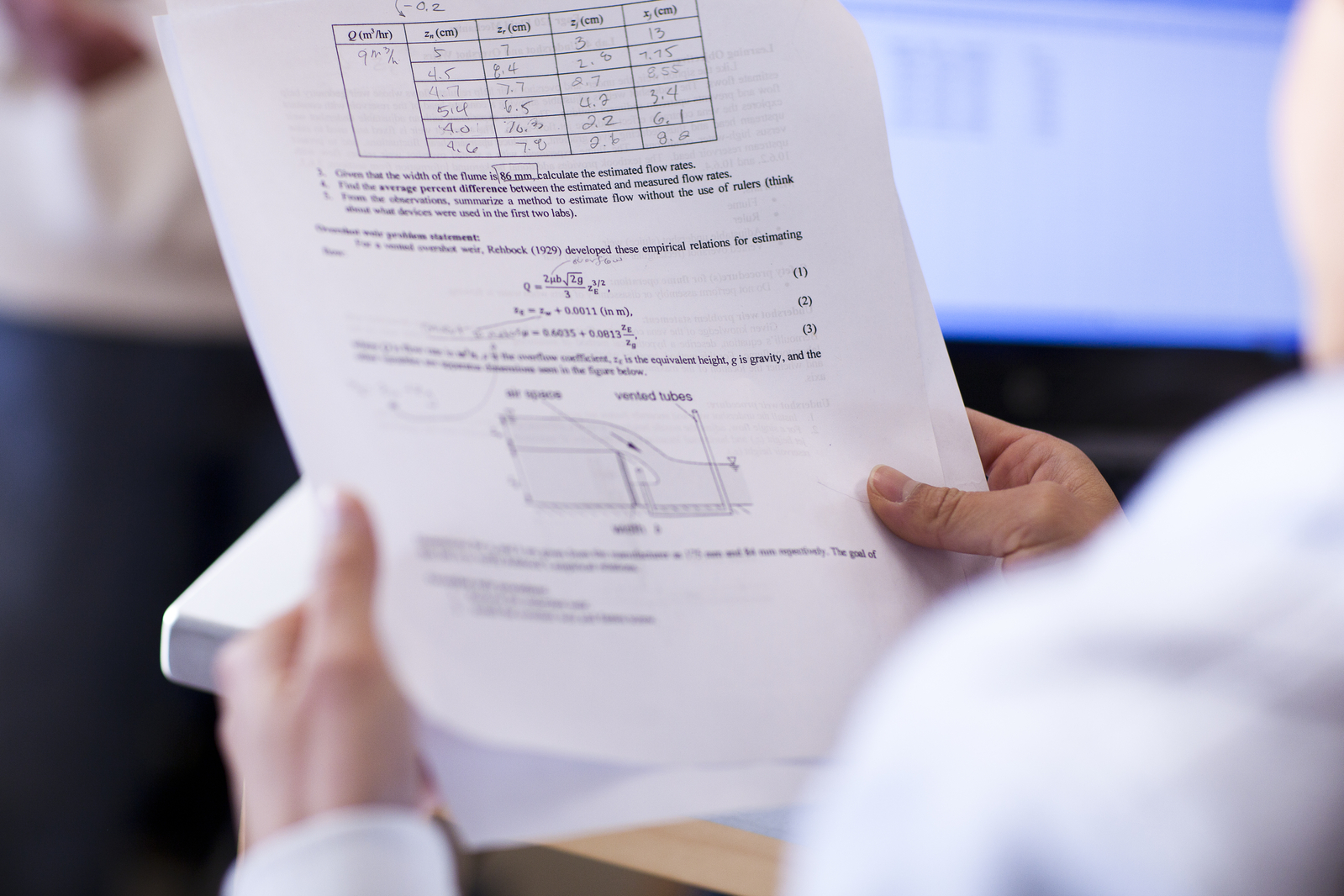 Researcher reviewing data on paper